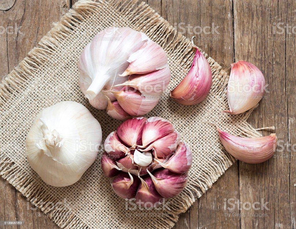 Fresh garlic on wooden background stock photo