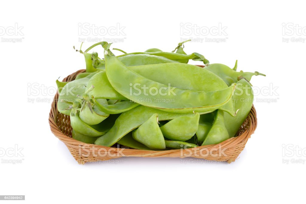 fresh giant sugar pea in bamboo basket and on white stock photo