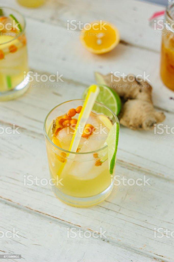 Fresh Ginger lemonade over white wooden background stock photo