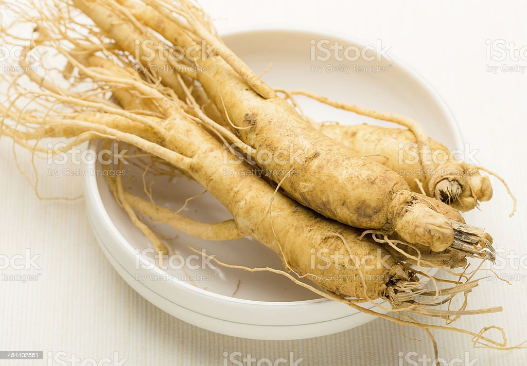Fresh ginseng root texture stock photo