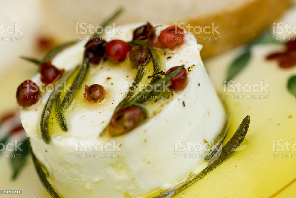 fresh goat cheese with extra virgin olive oil royalty-free stock photo