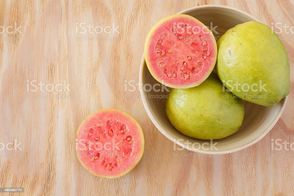 Fresh goiaba on wooden table stock photo
