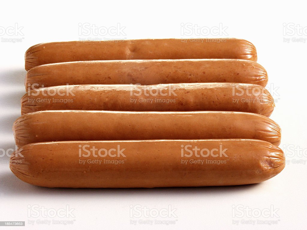 fresh gold chicken sausages pyramid on white royalty-free stock photo
