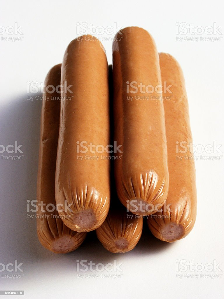 fresh gold chicken sausages pyramid on white stock photo
