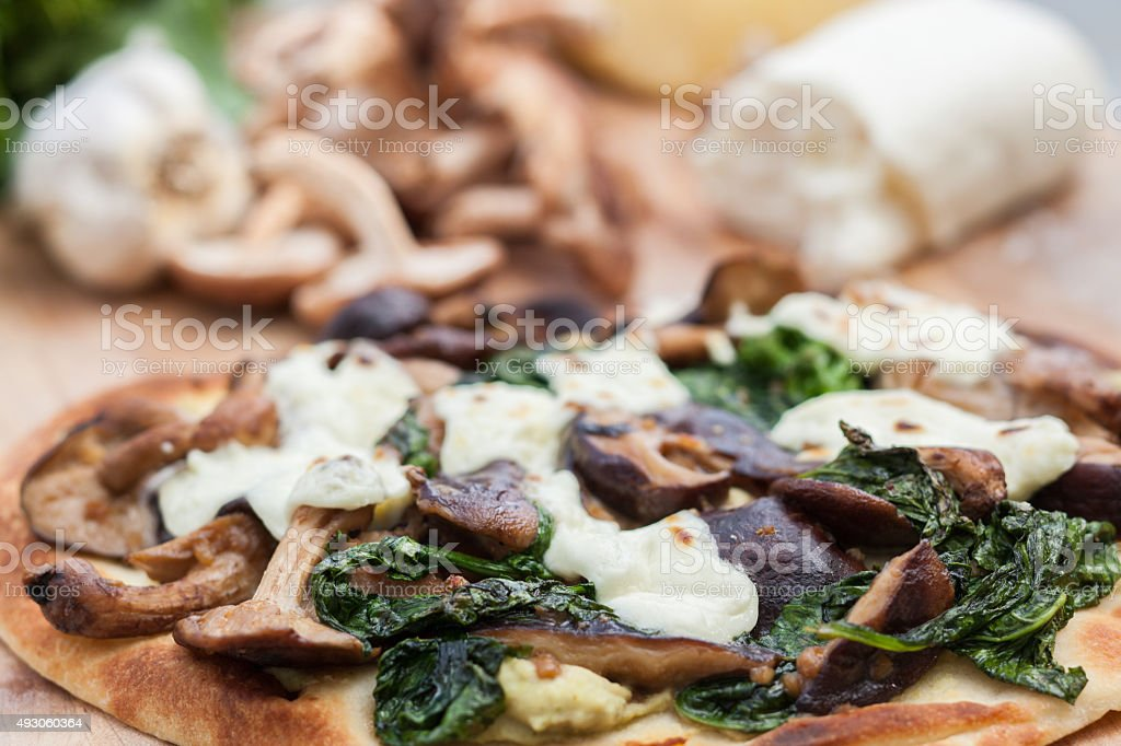 Fresh gourmet flatbread pizza with healthy ingredients stock photo
