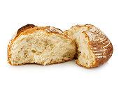 Fresh grain homemade bread cut in half on white background.