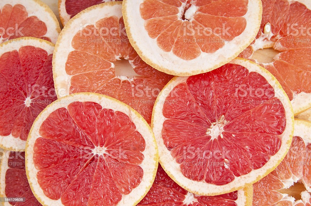 fresh grapefruit and slices stock photo