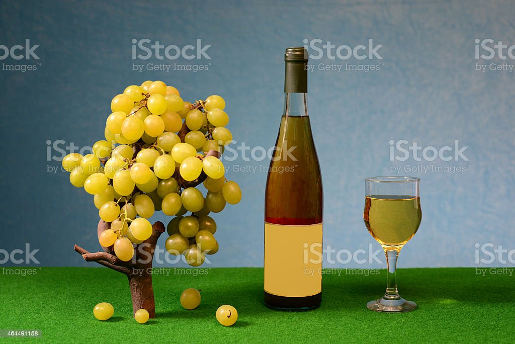 Fresh grapes and wine in the bottle and glass stock photo