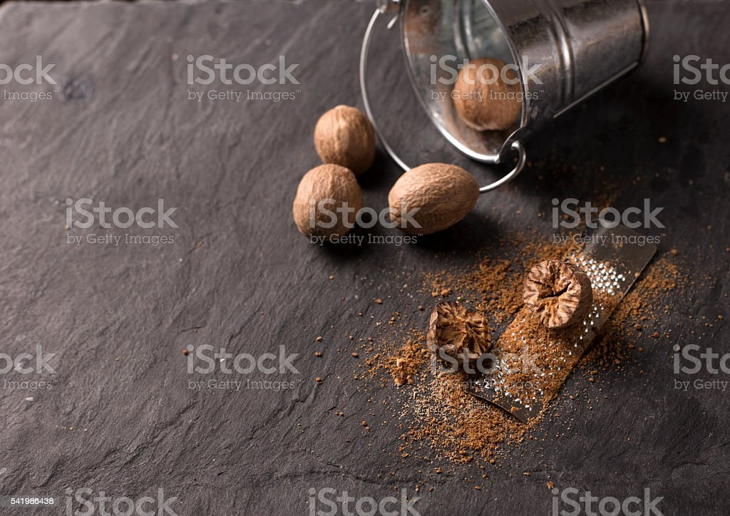 fresh grated nutmeg stock photo