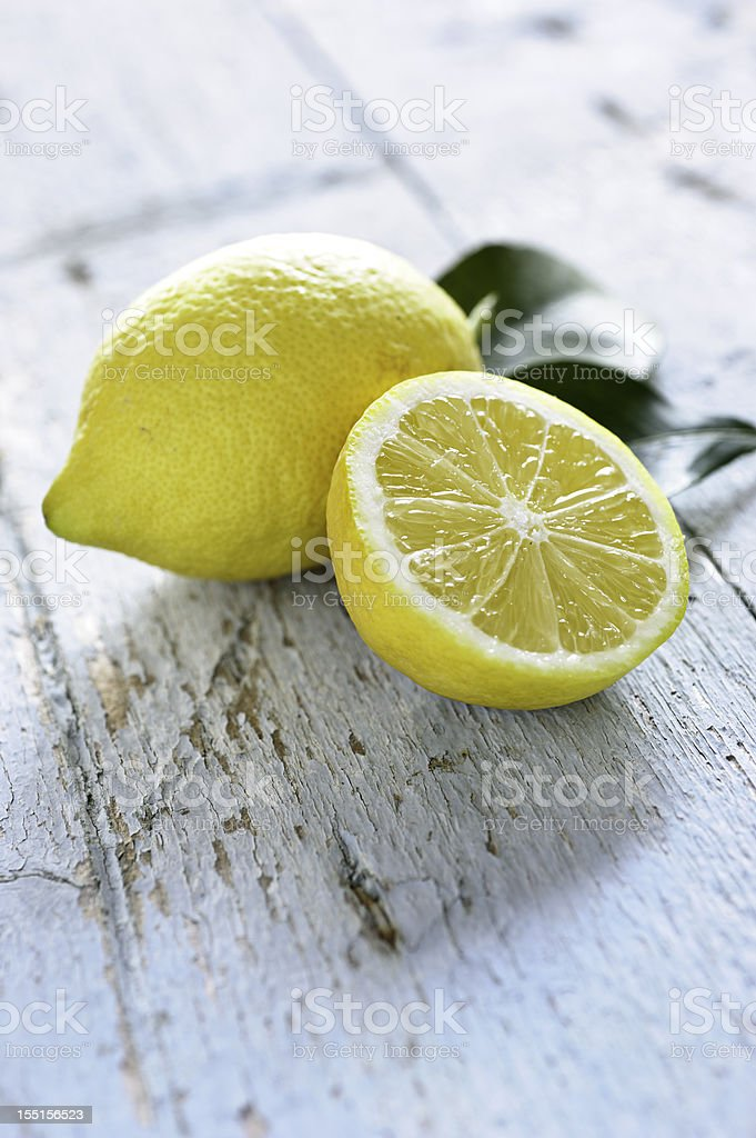 Fresh Lemons on blue rustic table royalty-free stock photo