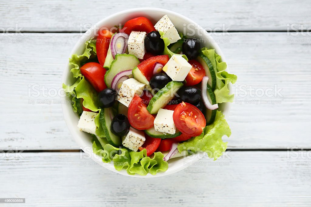 Fresh Greek salad in a bowl stock photo