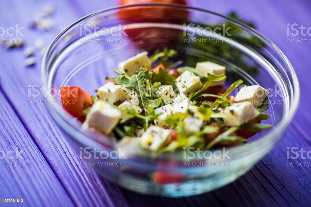Fresh Greek salad in a bowl, top view on wooden table stock photo