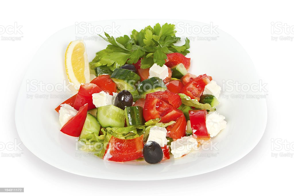 fresh Greek salad in white bowl royalty-free stock photo