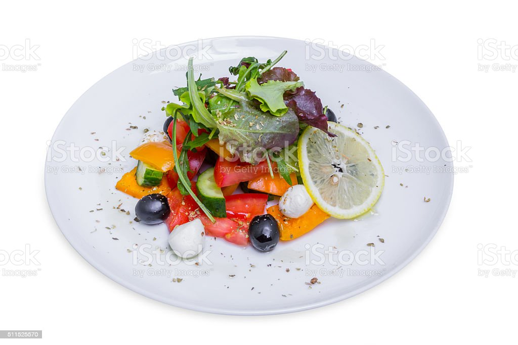 Fresh Greek salad, isolated with clipping path stock photo