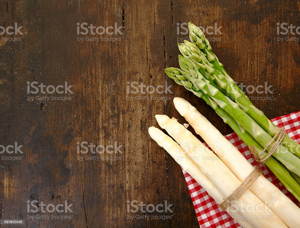 Fresh green and white asparagus with copyspace stock photo