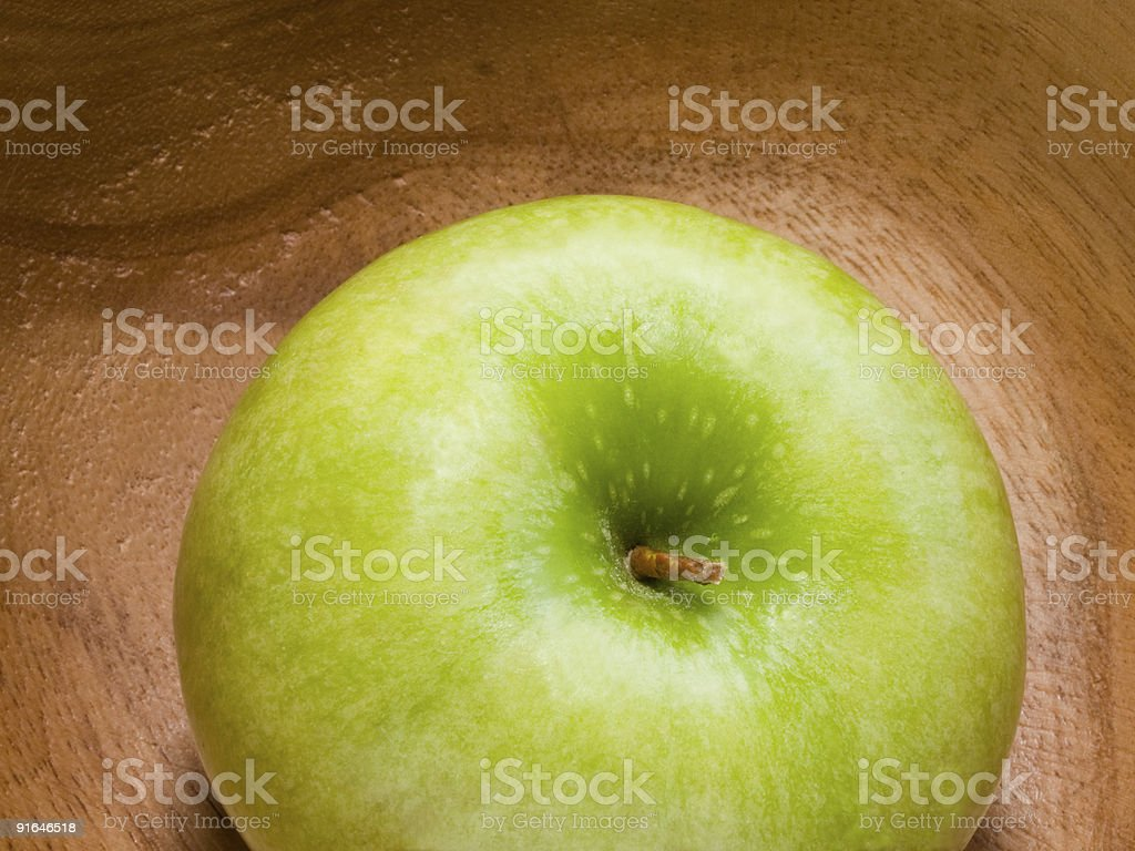 fresh green apple at wooden plate royalty-free stock photo