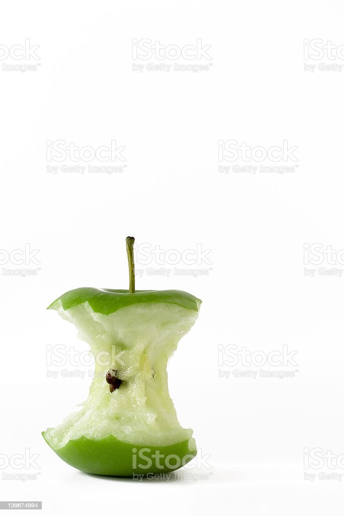 Fresh green apple eaten to the core royalty-free stock photo