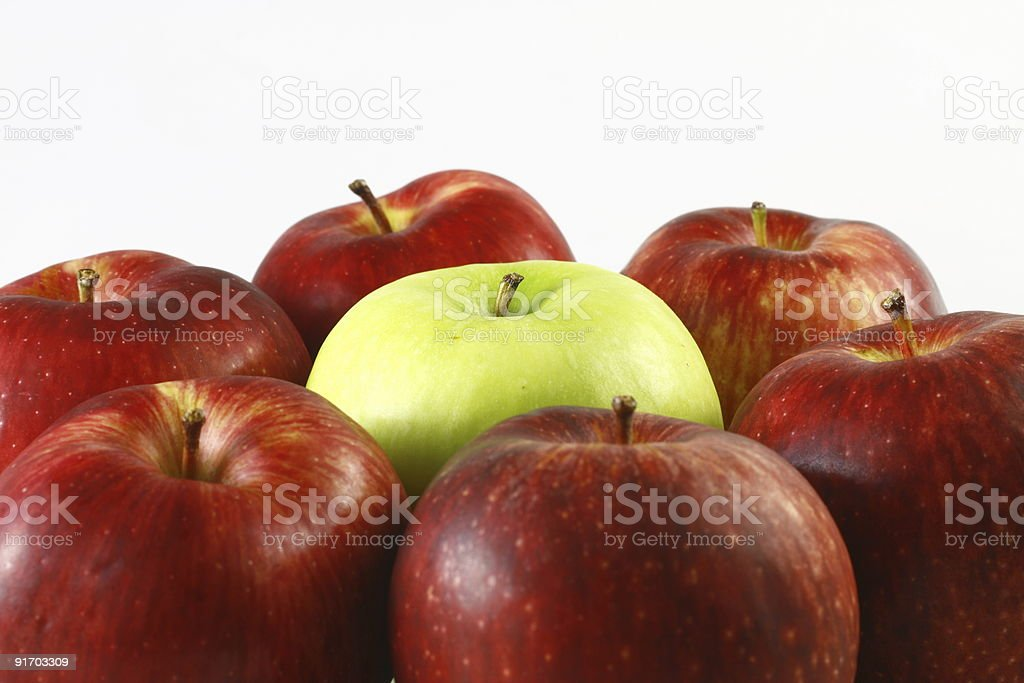 Fresh green apple in red apples stock photo
