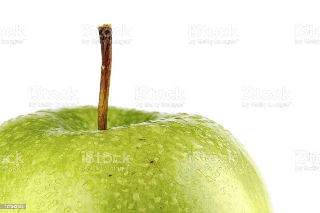 Fresh green apple with dew drops stock photo