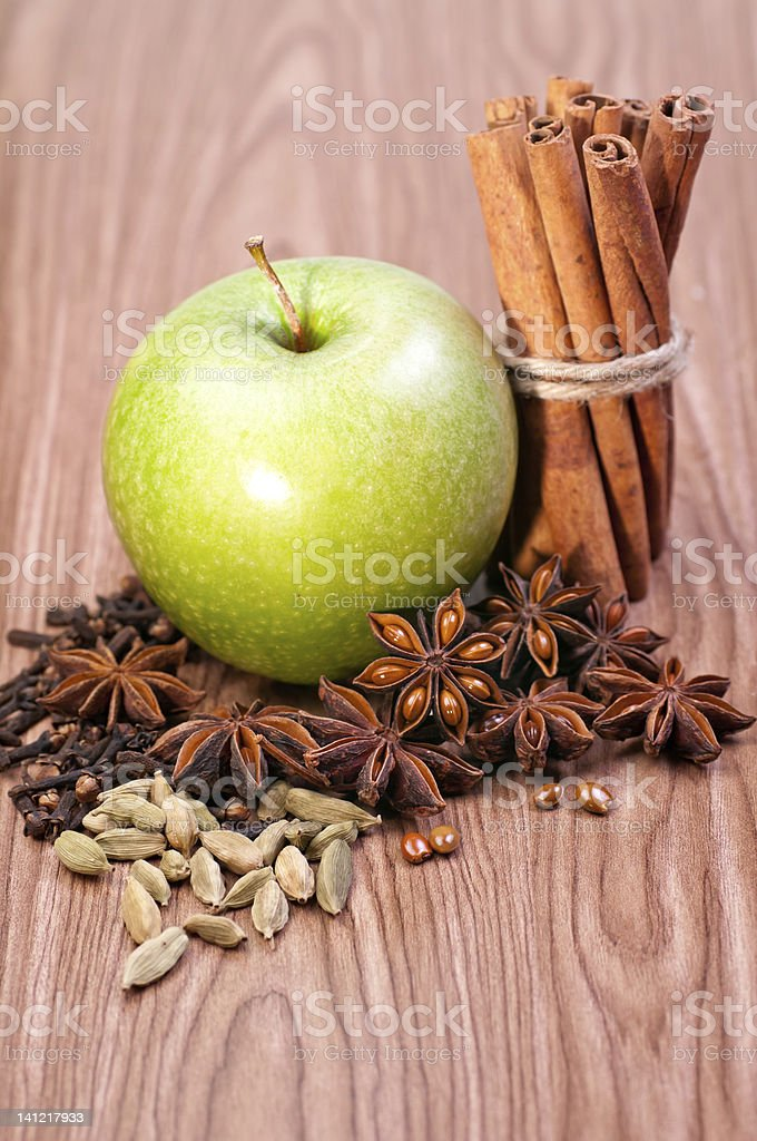 Fresh green apple with spices royalty-free stock photo