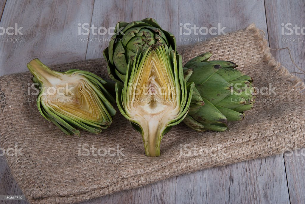 Fresh green artichokes ready to be cooked. stock photo