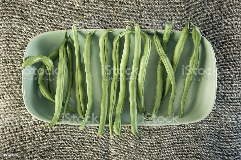 Fresh green beans in a bowl royalty-free stock photo