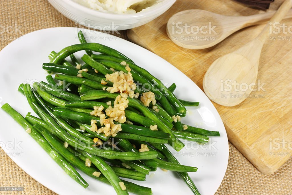 Fresh green beans serves with crushed nuts royalty-free stock photo