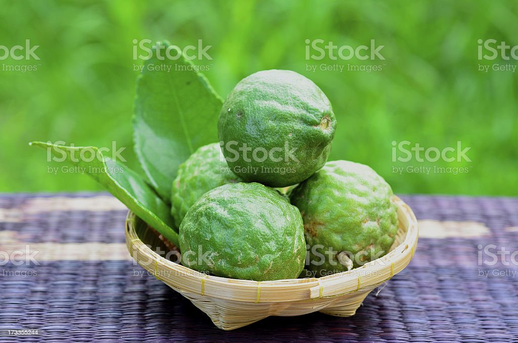 Fresh green bergamot fruit with great compose in basket stock photo