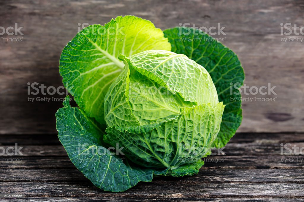 Fresh Green cabbage on old wooden table stock photo