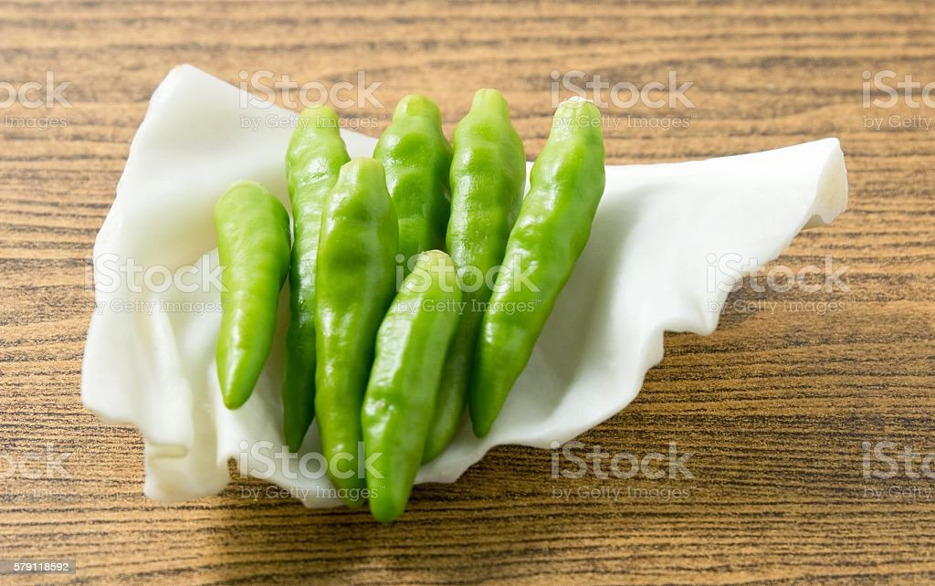 Fresh Green Chili Pepper on A Cabbage Leaf stock photo