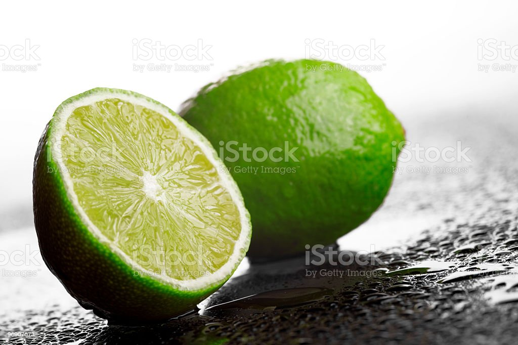 Fresh green lime cut in half royalty-free stock photo