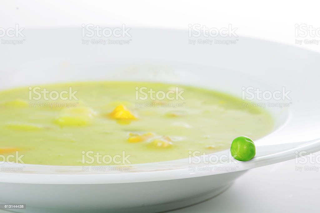 Fresh green pea on the edge of a soup  plate stock photo