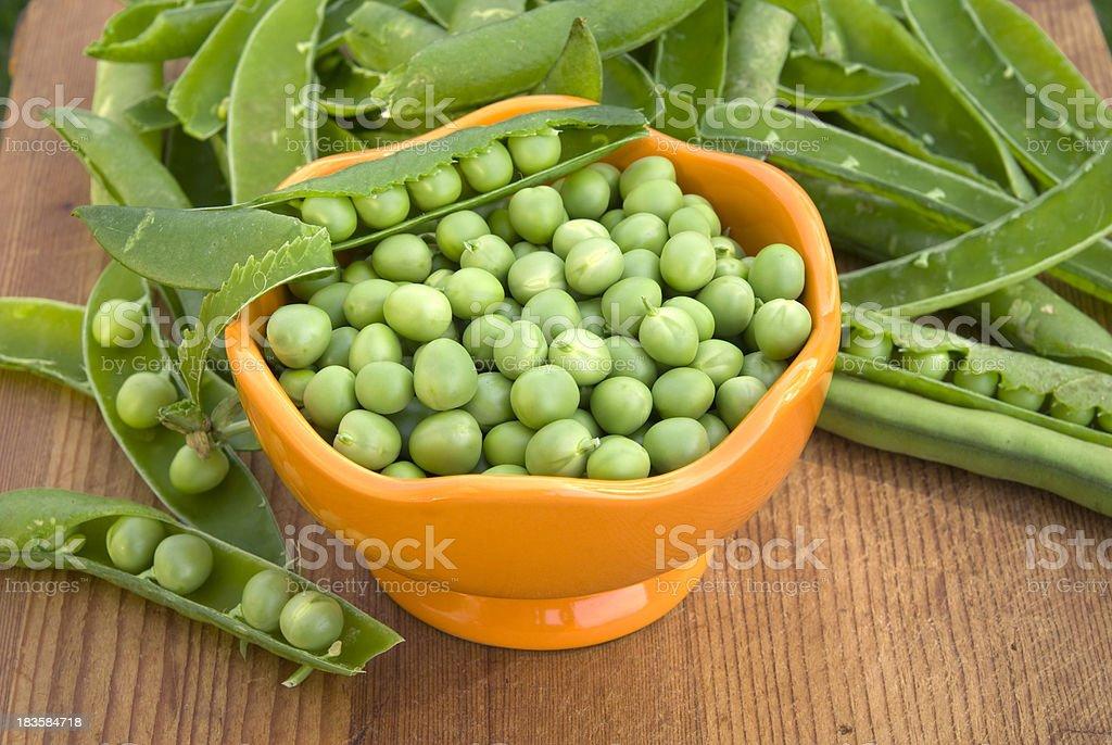 Fresh Green Peas, Cooking & Preparing Healthy Food, Spring Vegetable Background royalty-free stock photo