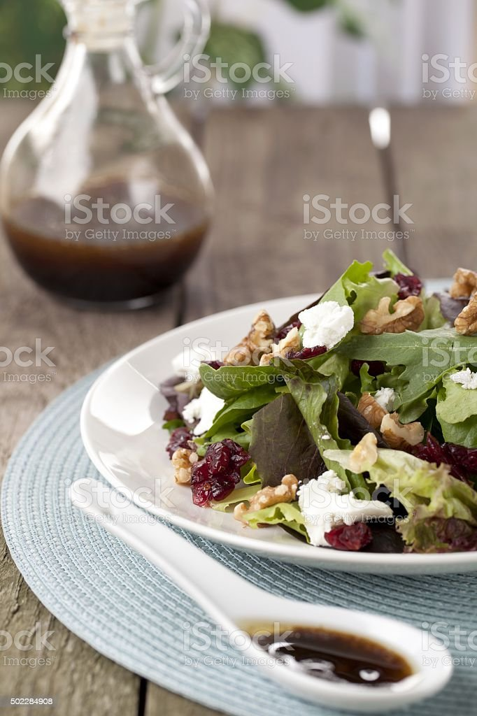 fresh green salad on a plate stock photo