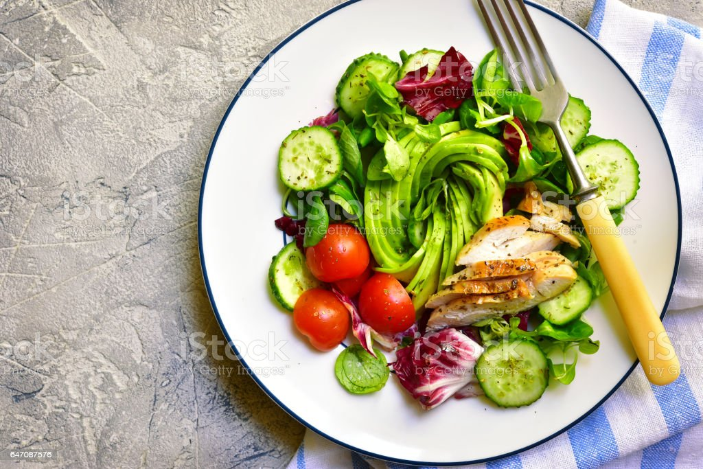Fresh green salad with grilled chicken stock photo