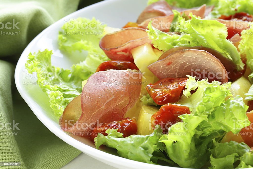 fresh green snack salad with ham and vegetables royalty-free stock photo