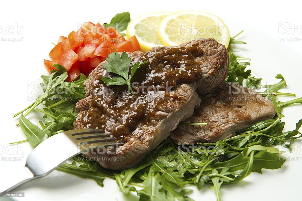 fresh grilled red meat with vegetables and sauce royalty-free stock photo
