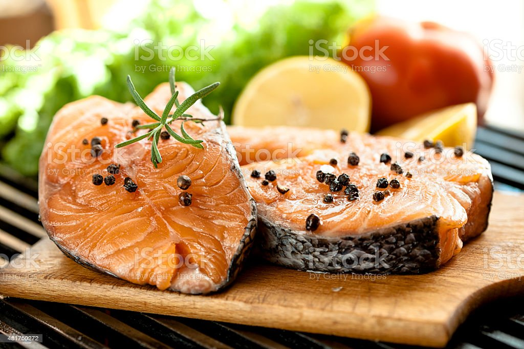 Fresh Grilled salmon steaks  on the cutting board stock photo