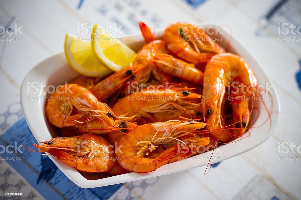 Fresh grilled shrimps with lemon, soft focus stock photo