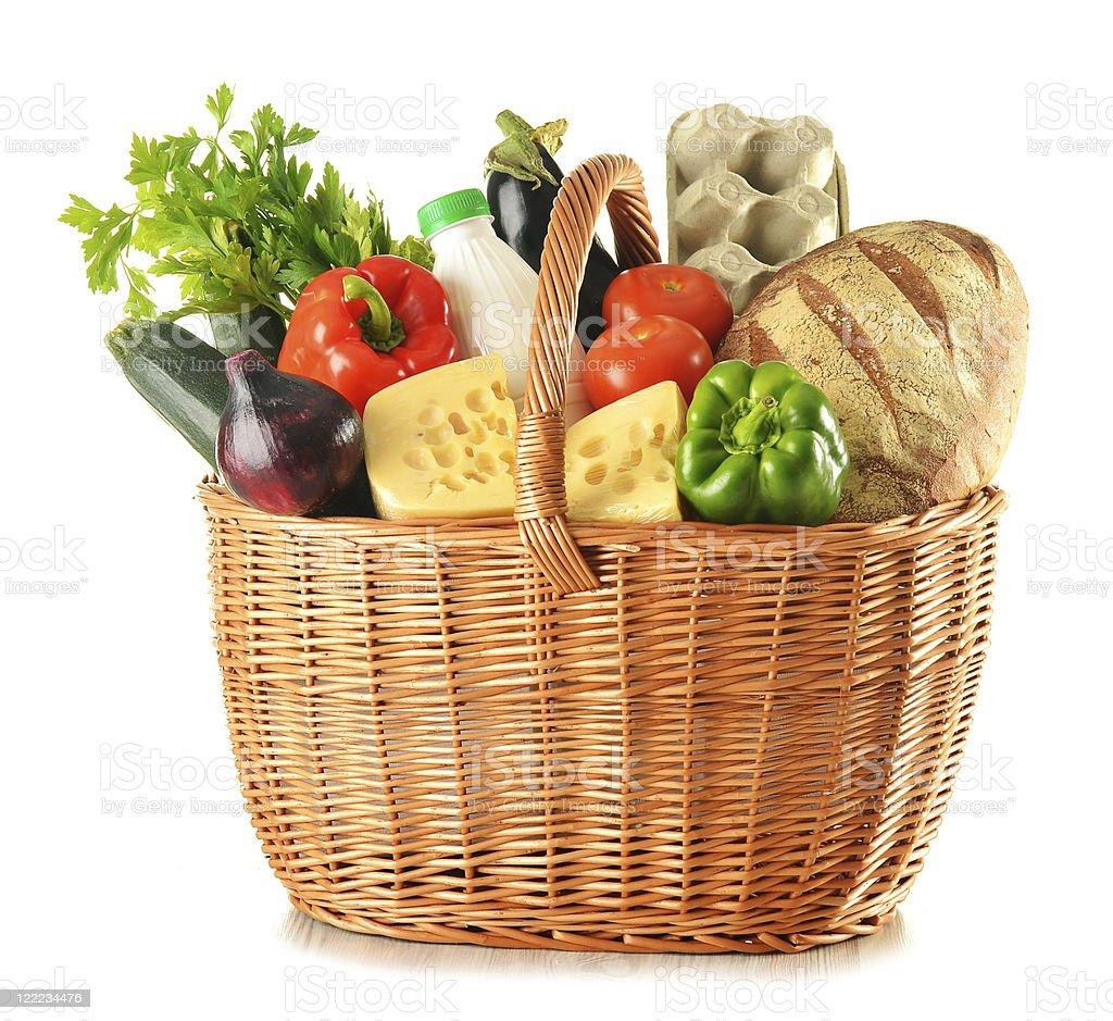 Fresh groceries in wicker basket stock photo
