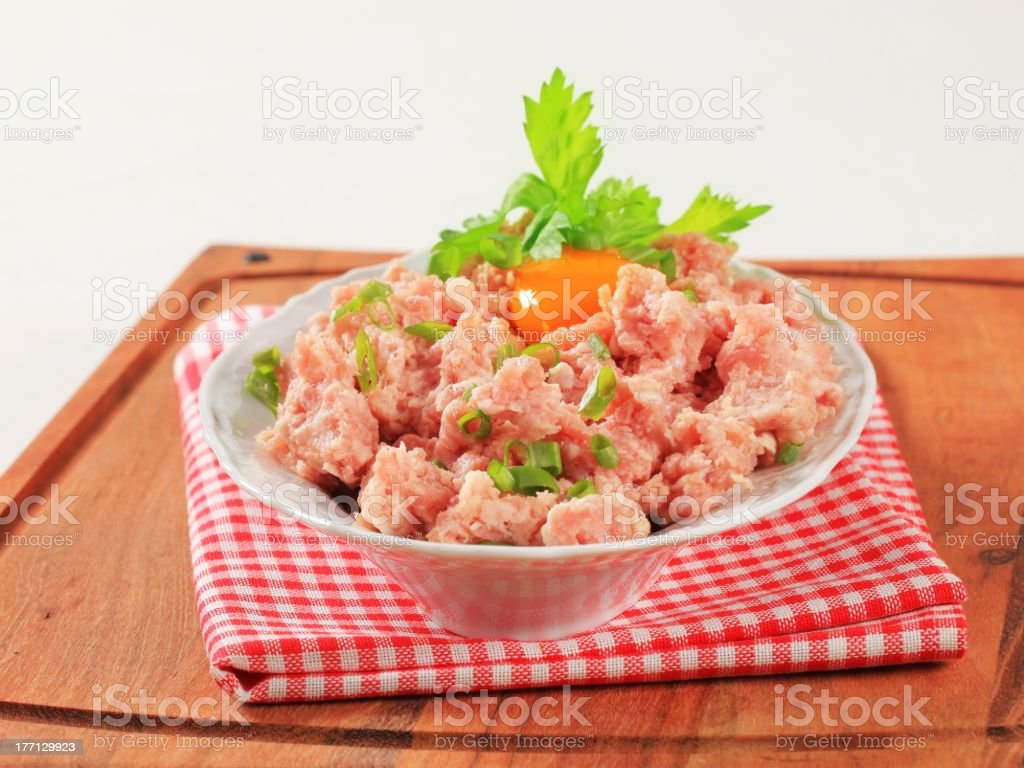 Fresh ground meat and egg yolk in a bowl royalty-free stock photo