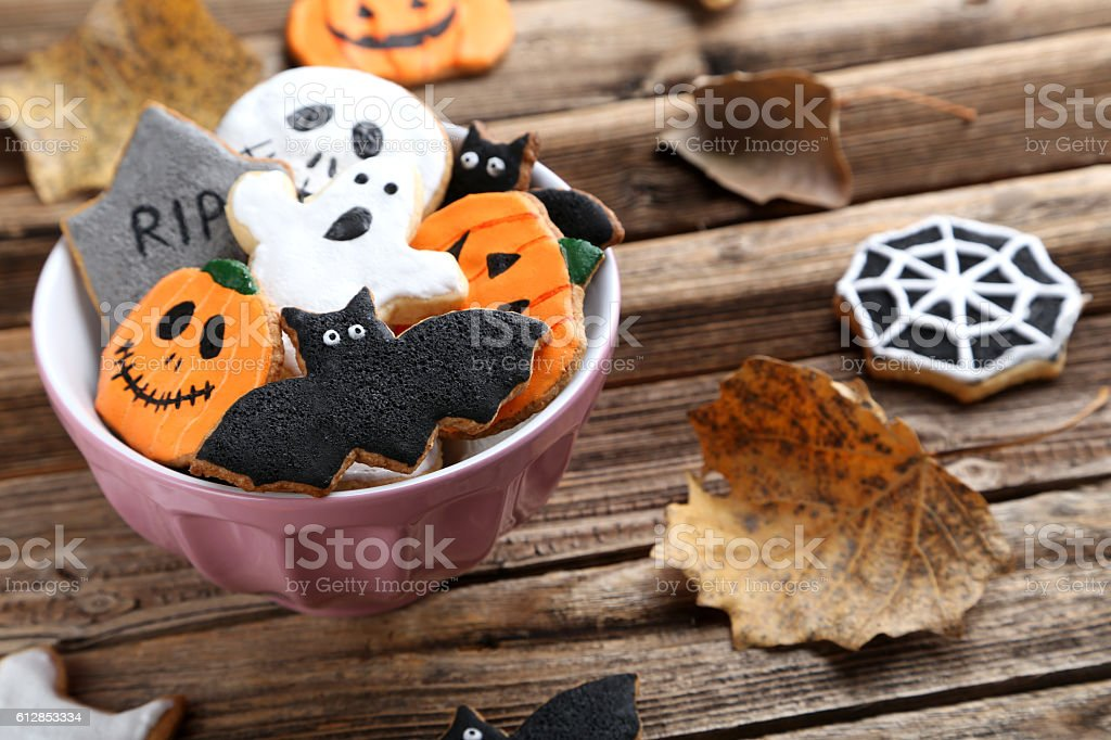 Fresh halloween gingerbread cookies on brown wooden table stock photo