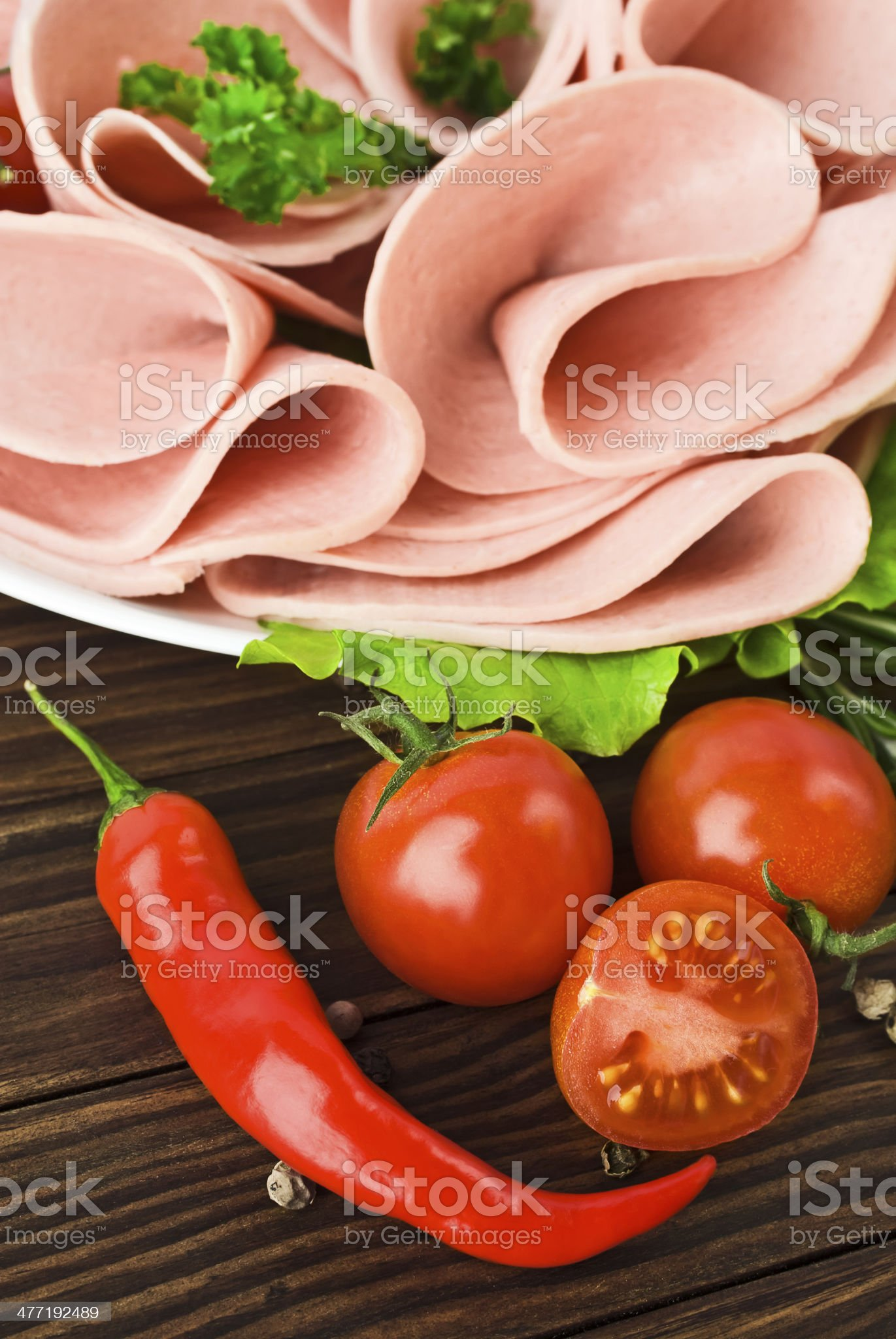 Fresh ham slices with lattuce and cherry tomato royalty-free stock photo