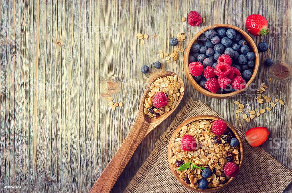 Fresh healthy breakfast with granola and berries, copy space rus stock photo
