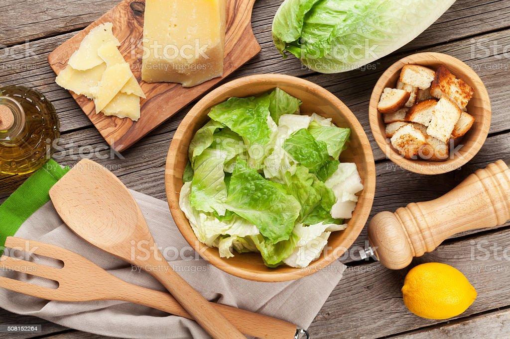 Fresh healthy caesar salad cooking stock photo