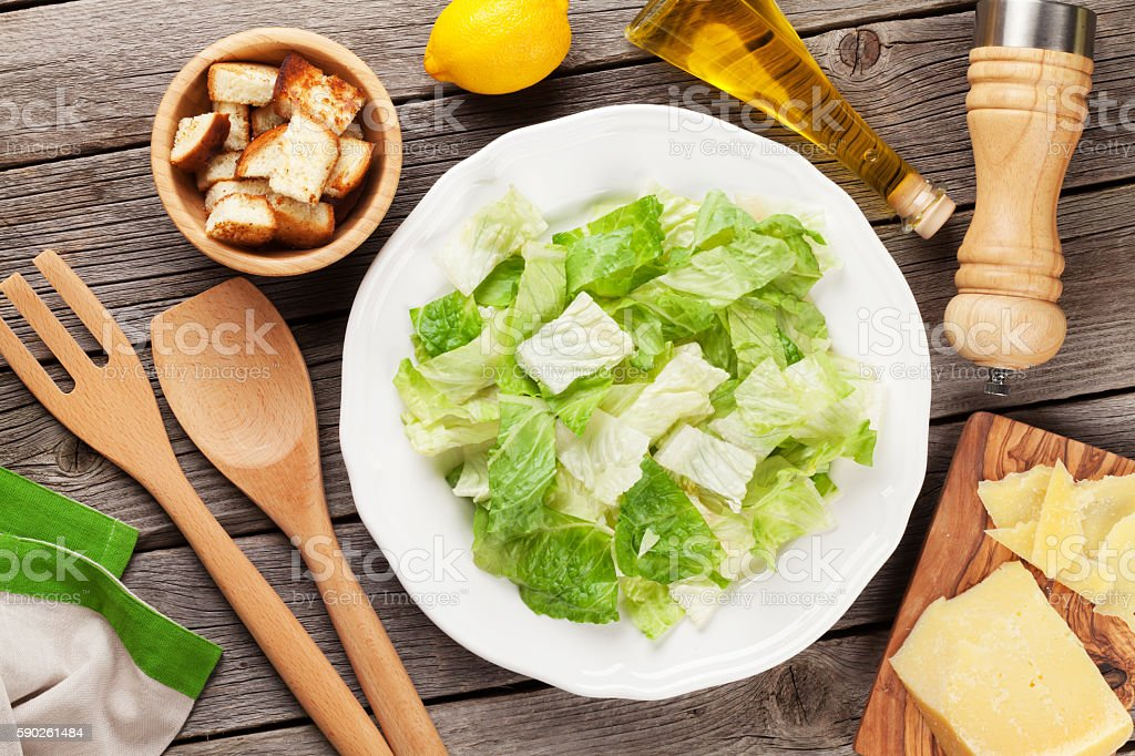 Fresh healthy caesar salad cooking stock photo