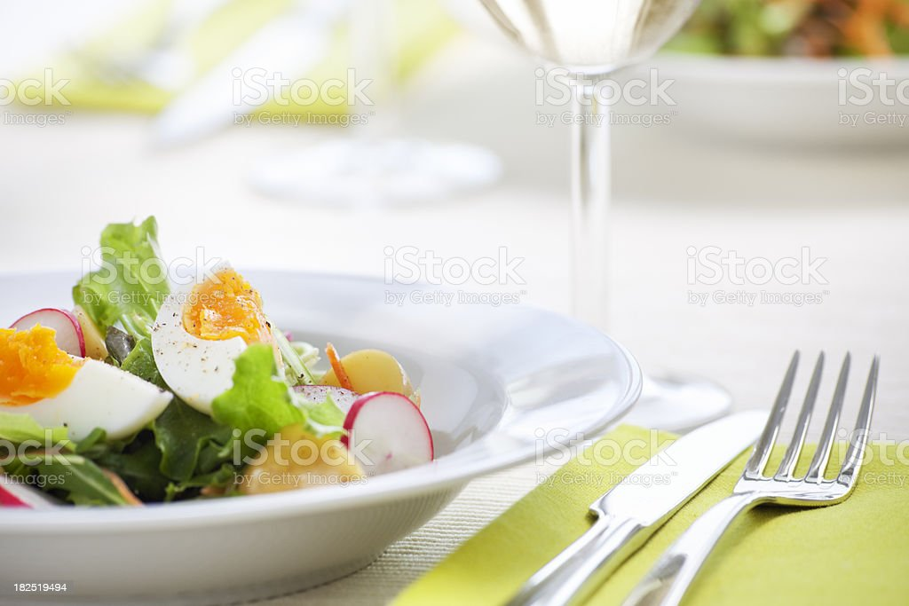 Fresh healthy salad on a table in bright light stock photo