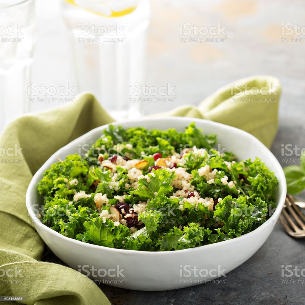 Fresh healthy salad with kale and quinoa stock photo