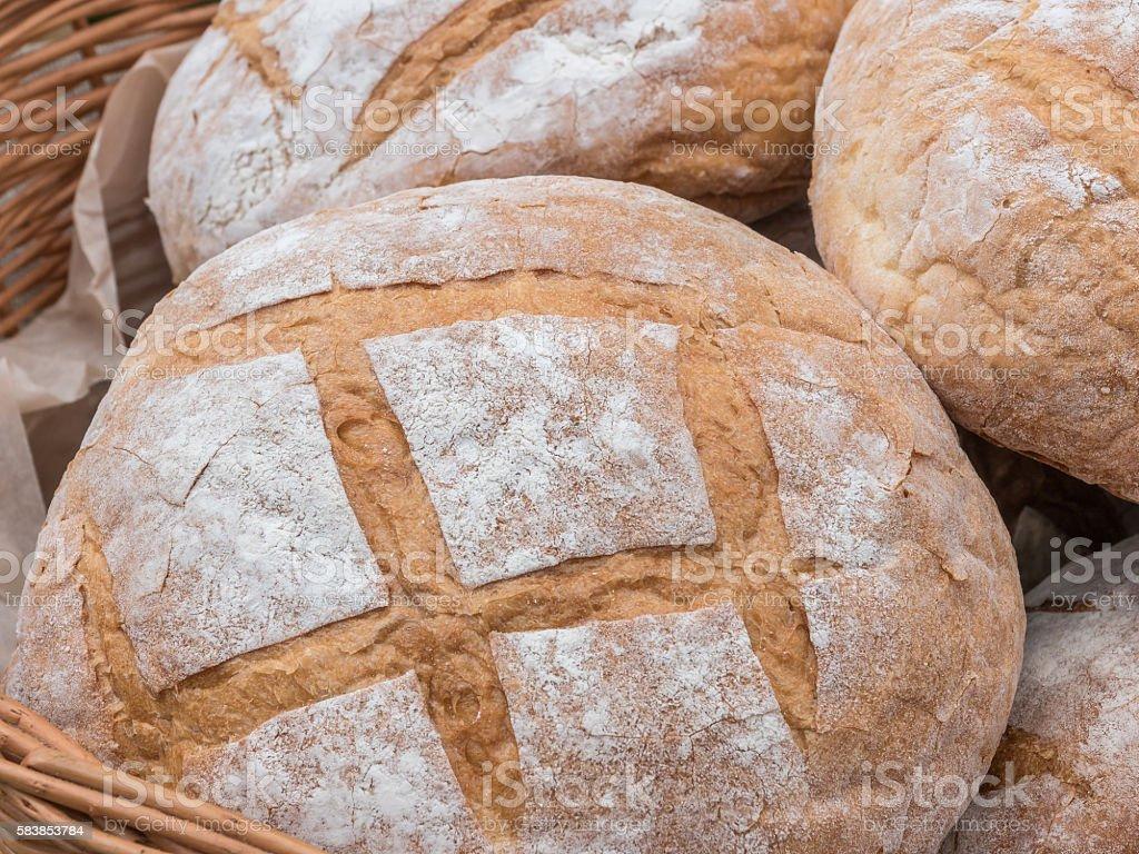 Fresh hearth bread in basket stock photo