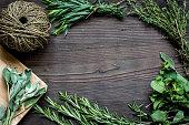 fresh herb frame on dark wooden background top view